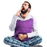 Pajamas Affect Sleep: Man in pajamas yawning
